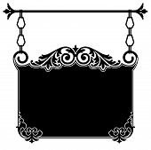 picture of scrollwork  - Wrought iron ornate vintage sign bracket in black and white with intricate scrollwork hanging from chain links from a rod for the front of an old town shop available in several different formats in gallery - JPG