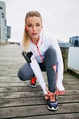pic of lace  - Pretty young woman tying her shoe laces before a run - JPG