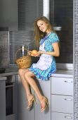 Housewife With Basket In The Kitchen