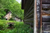 stock photo of water-mill  - Old forsaken water mill with an old barn - JPG