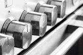 stock photo of combustion  - Close up image of stainless steel cooker knobs - JPG