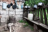 pic of junk-yard  - Pots and junk in the nook of the yard of one Romanian village - JPG