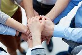 picture of joining hands  - Business partners hands on top of each other symbolizing companionship - JPG