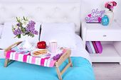 stock photo of bed breakfast  - Light breakfast and beautiful bouquet on bed - JPG