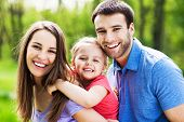stock photo of family bonding  - Happy family outdoors - JPG