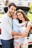 image of family bonding  - Happy family with car on background - JPG
