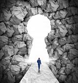 stock photo of waste management  - Management solutions direction concept as a business leadership symbol with a businessman walking to a glowing key hole shape opening made of crumpled paper - JPG