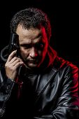 stock photo of private investigator  - Private detective with leather jacket and gun - JPG
