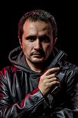 foto of private investigator  - Private detective with leather jacket and gun - JPG