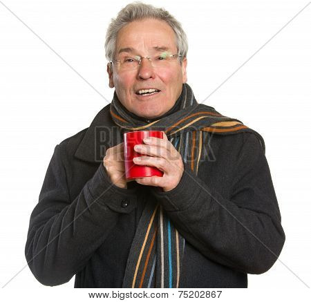 Senior Man In Winter Clothing Holding Cup
