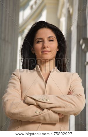cross-armed businesswoman looking