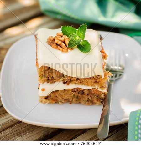 A Piece Of Moist Zucchini And Walnut Cake With Cream Cheese Frosting