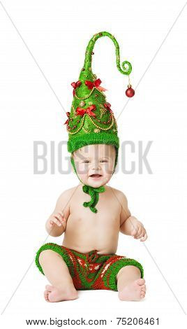 Christmas Baby Kid In Green Hat Decoration As Xmas Tree, Child Sitting Isolated White Background