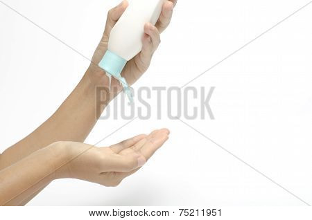 Woman Pouring Body Lotion On Hand