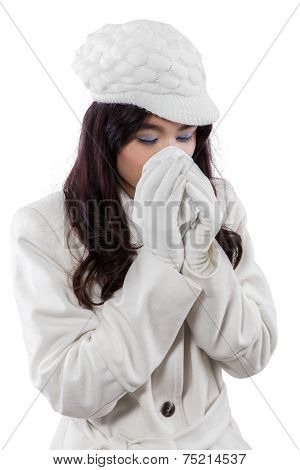 Hispanic Woman Sneezing With A Handkerchief