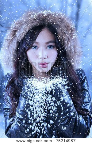 Woman Blowing Snow To Camera