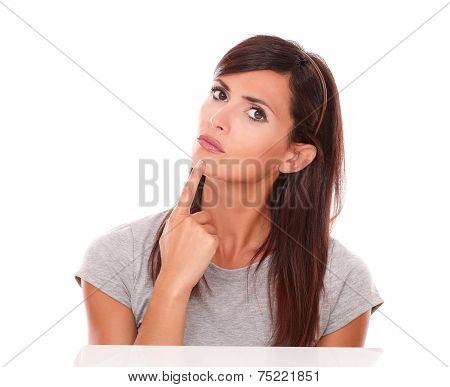 Beautiful Woman Wondering With Her Finger On Chin