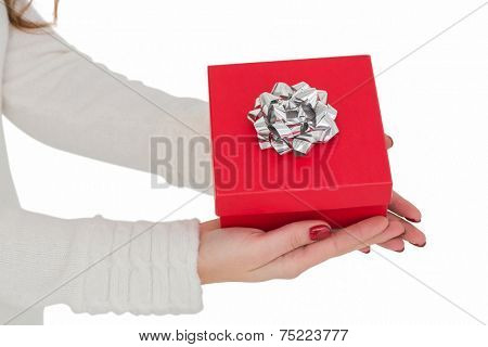 Woman with nail varnish holding red gift on white background