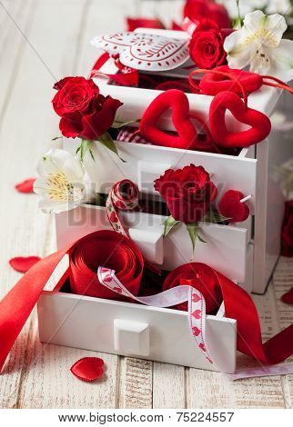 White box with various  decorations  for Valentine's Day