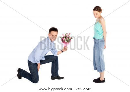 Casual Man Offering Flowers To Woman