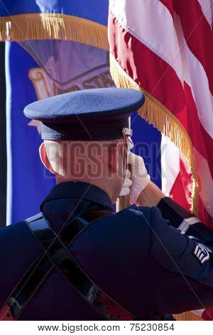 NEW YORK - NOV 11, 2013: A member of the US Air Force Honor Guard holds the American Flag during the 2013 America's Parade held on Veterans Day in New York City on November 11, 2013.