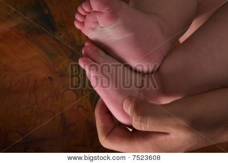 Feet and hands of a baby