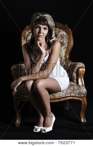 Beautiful young woman on chair
