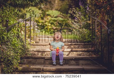 Laughing girl on stairs