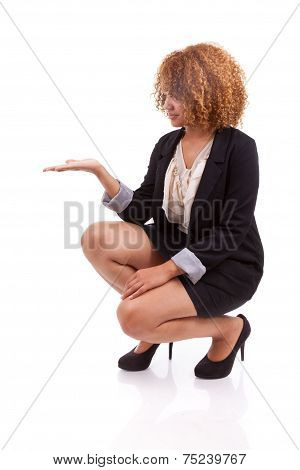 Portrait Of A Young African American Business Woman Holding Something In Her Hand Palm - Black Peopl