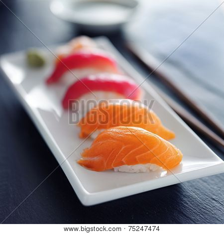 japanese salmon and tuna nigiri on white plate