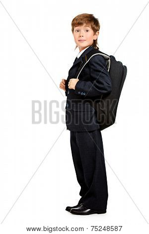 Full length portrait of a boy in a formal suit with schoolbag. Education. Copy space. Isolated over white.