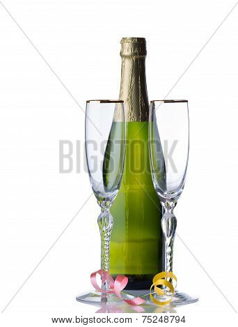 Unopened Bottle Of Sparkling Wine With Tall Glasses Ready For The Holidays
