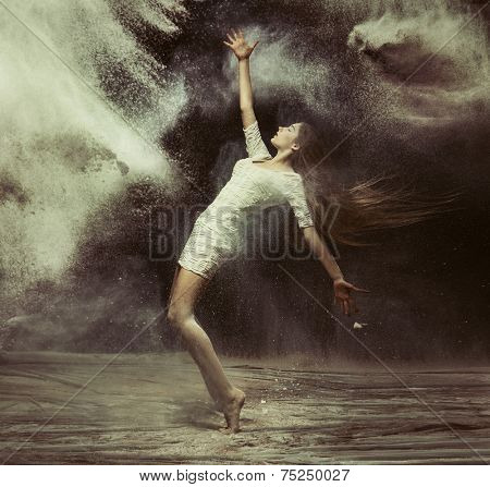 Fine art photo of a beautiful girl dancing