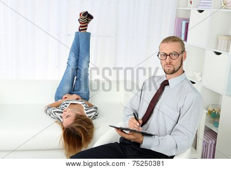 Young girl on reception at psychologist
