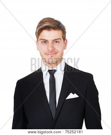Smiling Businessman Against White Background