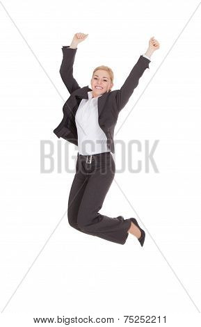 Successful Businesswoman Jumping Against White Background