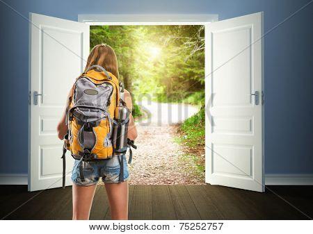 Traveler woman is going to opened doors