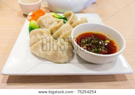 Traditional Chinese Dumpling With Dipping Sauce