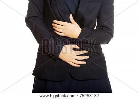 Young businesswoman with stomach ache