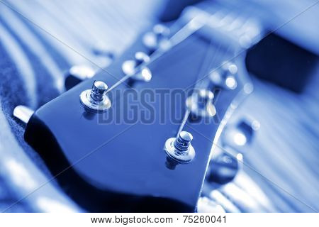 the neck of the guitar