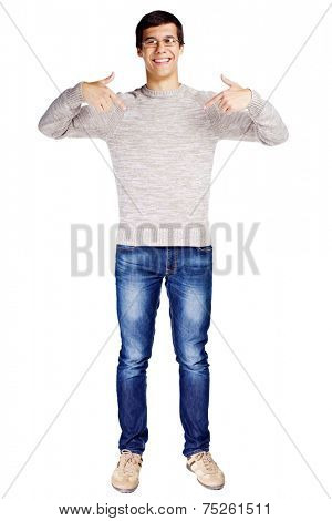 Full length portrait of smiling young man in glasses and beige sweater pointing at himself with fingers on isolated white background