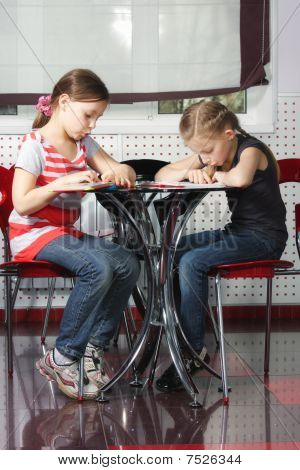 Girls Reading Books In Cafe