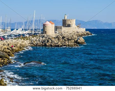 Harbor Windmills And Lighthouse. Rhodes, Greece