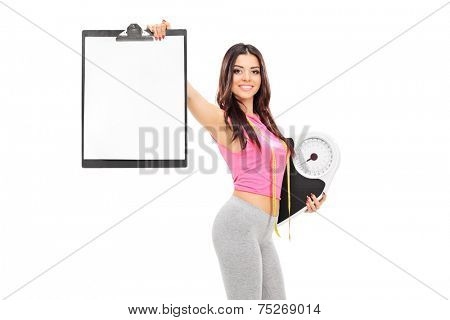 Female athlete holding a clipboard and a weight scale isolated on white background