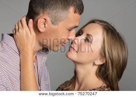 Enamoured young man and woman about to kiss