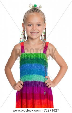 Lovely girl in a colorful summer dress isolated on white background. Girl is six years old.