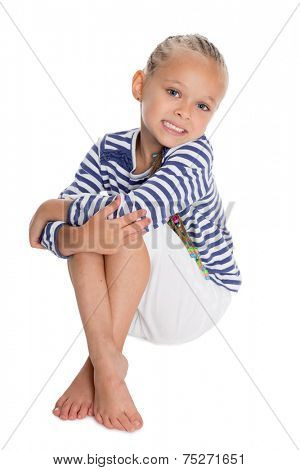 Little girl dressed as a sailor boy. Girl is six years old.