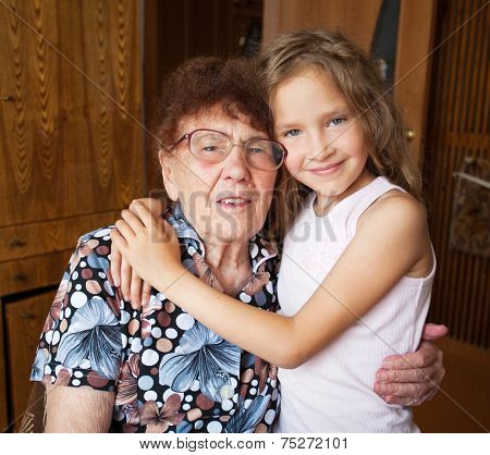 Senior with girl. Generation. Elderly woman with great-grandchild