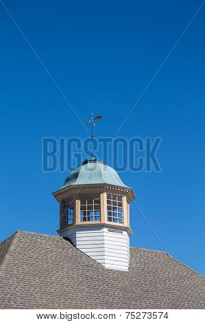Wind Vane On Cupola Under Clear Blue Sky