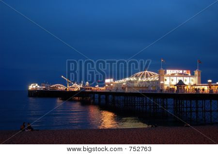 The Palace Pier in Brighton UK by Night